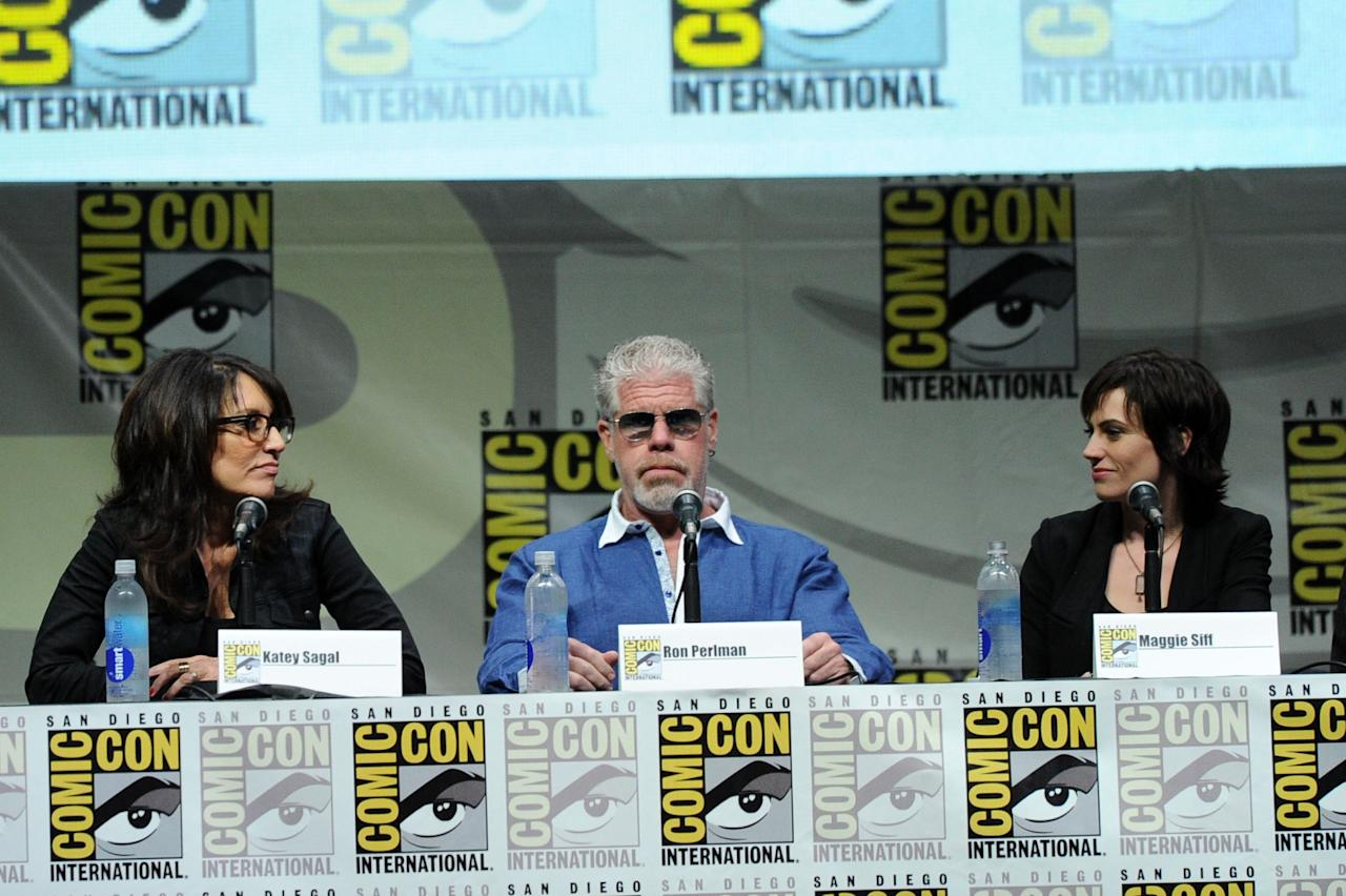 """SAN DIEGO, CA - JULY 21: Actors Katey Sagal, Ron Perlman and Maggie Siff speak onstage at the """"Sons Of Anarchy"""" panel during Comic-Con International 2013 at San Diego Convention Center on July 21, 2013 in San Diego, California. (Photo by Kevin Winter/Getty Images)"""
