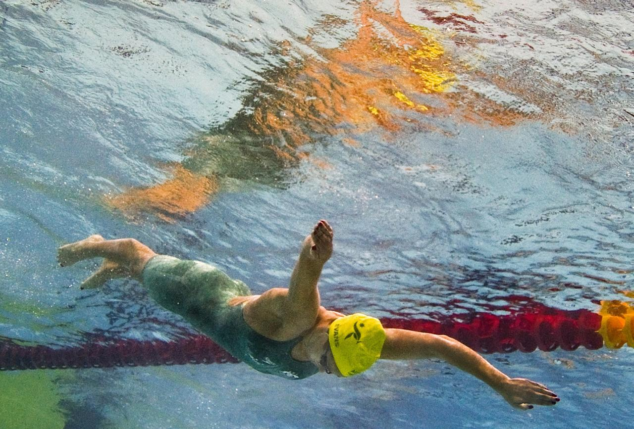 UNDERWATER CAMERA PHOTOGRAPH  Australian swimmer Blair Evans competes during a heat for the women's 400 metre individual medley event for The Commonwealth Games at the S.P. Mukherjee Aquatics Centre in New Delhi on October 9, 2010.   The Commonwealth Games are taking place in the Indian capital from October 3-14.  AFP PHOTO / FRANCOIS XAVIER MARIT (Photo credit should read FRANCOIS XAVIER MARIT/AFP/Getty Images)