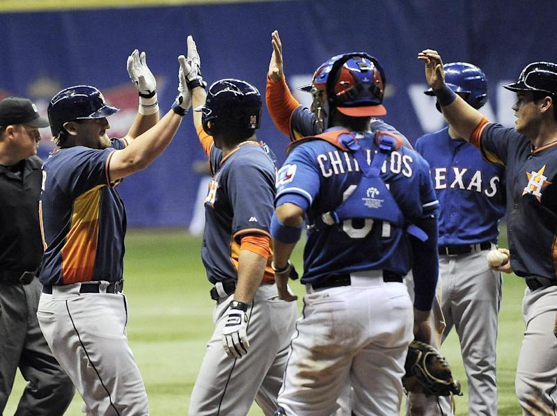 Astros slam Rangers 13-6 for Alamodome sweep