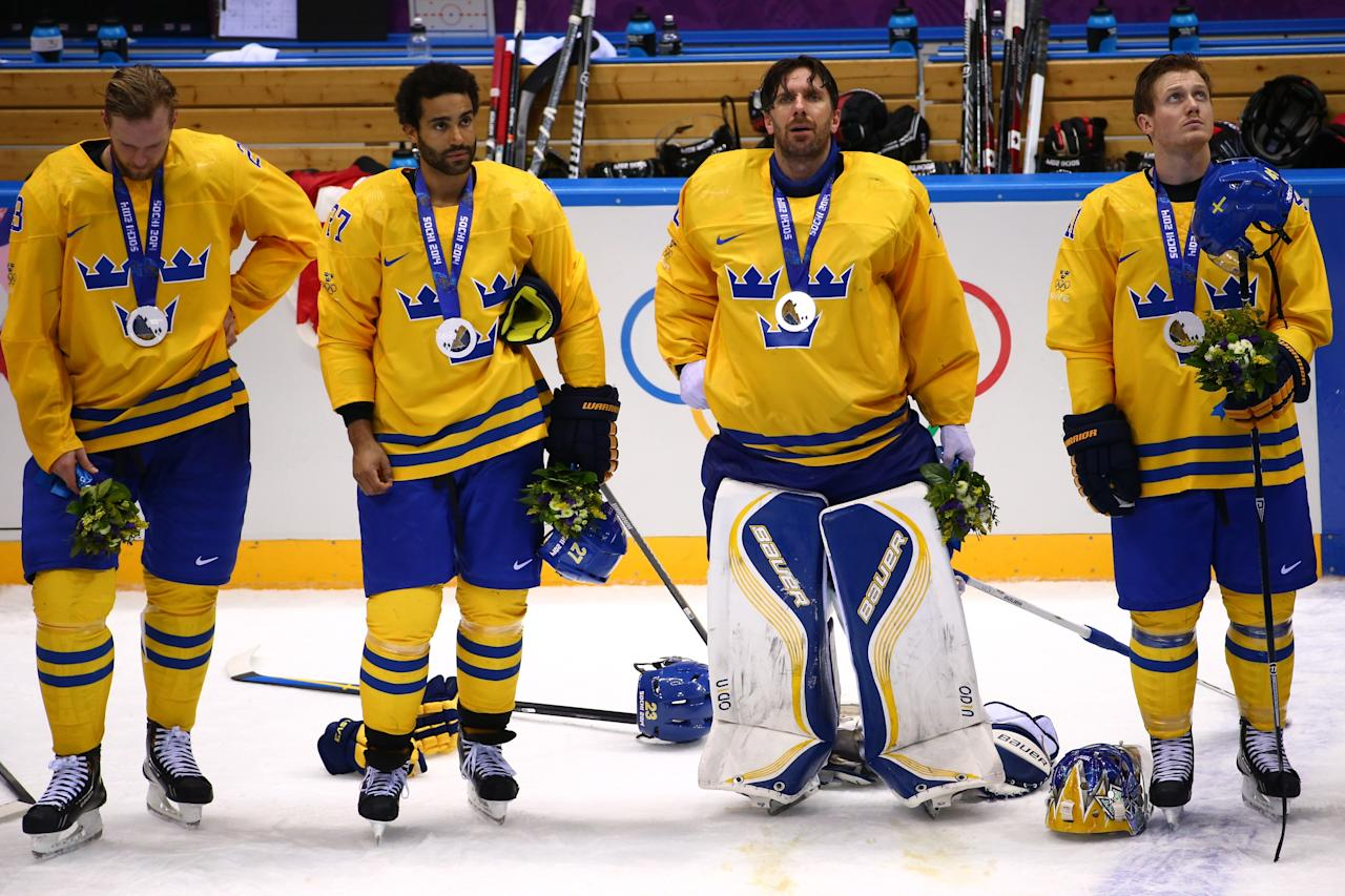 SOCHI, RUSSIA - FEBRUARY 23: Silver medalists Alexander Edler #23, Johnny Oduya #27, Henrik Lundqvist #30 and Henrik Zetterberg #40 of Sweden react during the medal ceremony after losing to Canada 3-0 during the Men's Ice Hockey Gold Medal match on Day 16 of the 2014 Sochi Winter Olympics at Bolshoy Ice Dome on February 23, 2014 in Sochi, Russia. (Photo by Streeter Lecka/Getty Images)