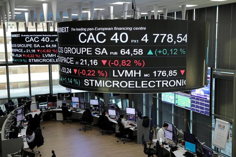 Stock index price for France's CAC 40 and company stock price information are displayed on screens as they hang above the Paris stock exchange operated by Euronext NV in La Defense business district in Paris