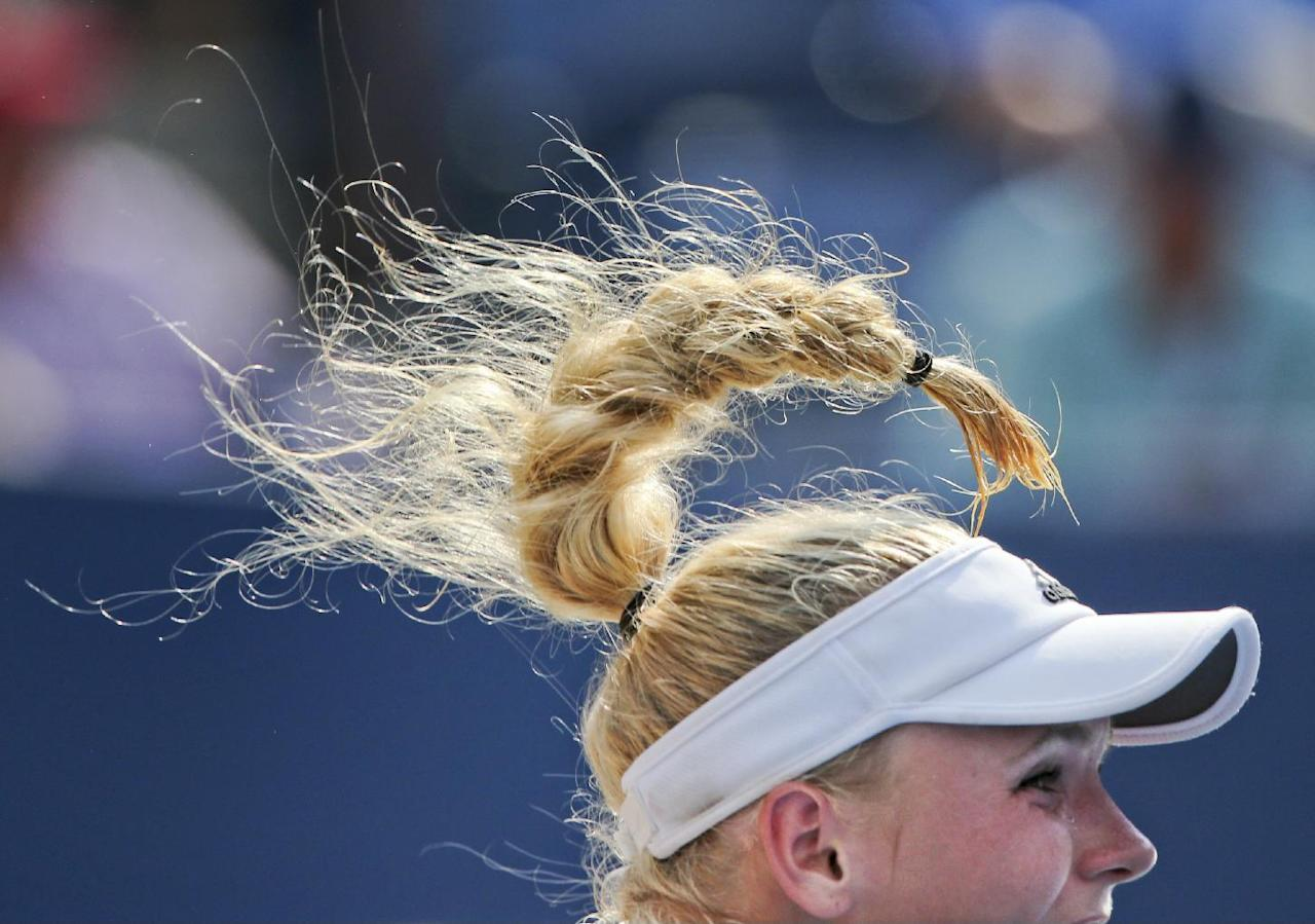 Caroline Wozniacki, of Denmark, serves against Peng Shuai, of China, during the semifinals of the 2014 U.S. Open tennis tournament, Friday, Sept. 5, 2014, in New York. (AP Photo/Mike Groll)
