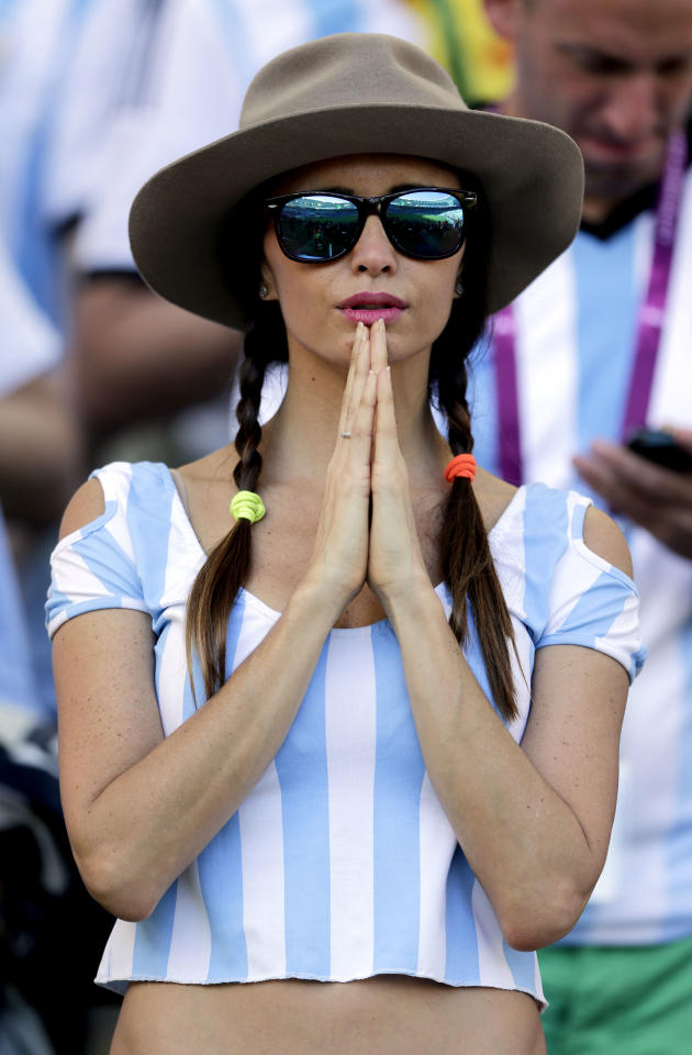 An Argentina gestures before the World Cup final soccer match between Germany and Argentina at the Maracana Stadium in Rio de Janeiro, Brazil, Sunday, July 13, 2014. (AP Photo/Matthias Schrader)