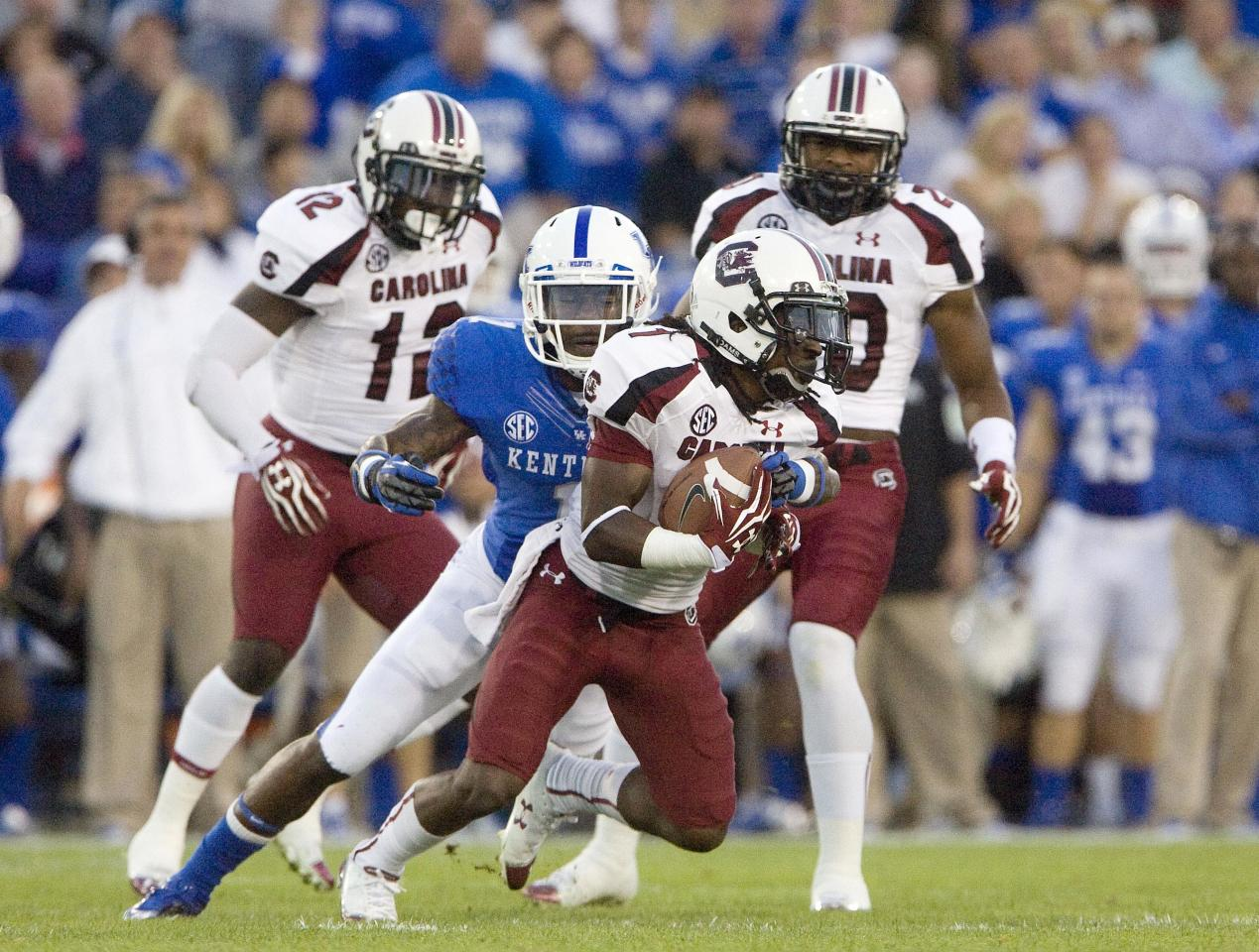 Sept 29, 2012; Lexington, KY, USA; Kentucky Wildcats cornerback Martavius Neloms (1) tackles South Carolina Gamecocks wide receiver Ace Sanders (1) during the first half at Commonwealth Stadium. Credit: Mark Zerof-US PRESSWIRE