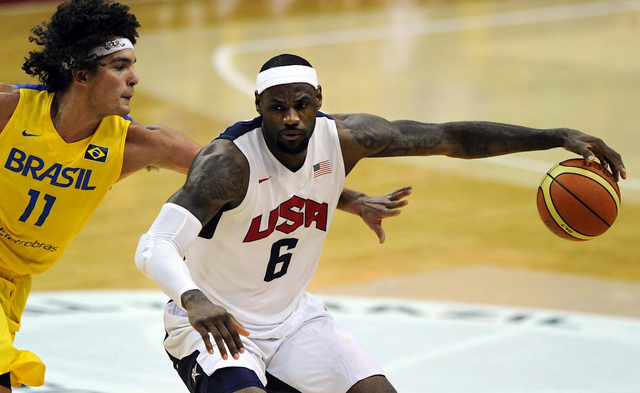 WASHINGTON, DC - JULY 16: LeBron James #6 of the US Men's Senior National Team dribbles past Anderson Franca Varejao #11 of Brazil in the third quarter during a pre-Olympic exhibition basketball game at the Verizon Center on July 16, 2012 in Washington, DC. The US Senior Men's National Team won, 80-69. (Photo by Patrick Smith/Getty Images)