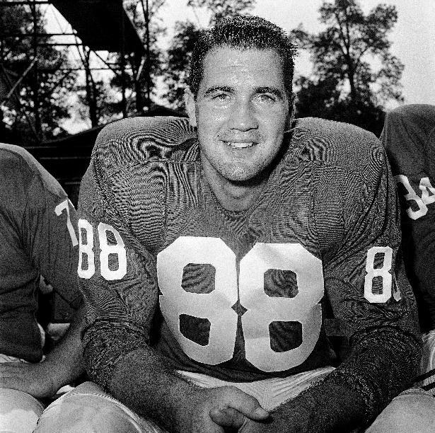 FILE - In this Sept. 17, 1960, file photo, New York Giants placekicker Pat Summerall poses for a portrait in New York. Fox Sports spokesman Dan Bell said Tuesday, April 16, 2013, that Summerall, the NFL player-turned-broadcaster whose deep, resonant voice called games for more than 40 years, has died at the age of 82. (AP Photo/John Rooney, File)