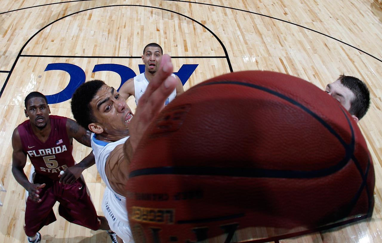 ATLANTA, GA - MARCH 11:  James Michael McAdoo #43 of the North Carolina Tar Heels battles for a rebound against Bernard James #5 of the Florida State Seminoles during the Final Game of the 2012 ACC Men's Basketball Conference Tournament at Philips Arena on March 11, 2012 in Atlanta, Georgia.  (Photo by Kevin C. Cox/Getty Images)