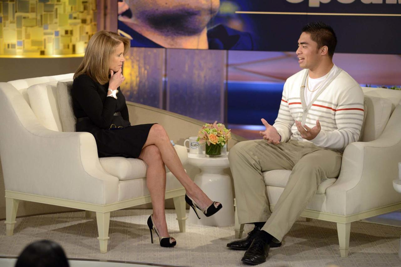 """This Jan. 22, 2013 photo released by ABC Notre Dame linebacker Manti Te'o, right, speaking with host Katie Couric during an interview for """"Katie,"""" in New York. Te'o has told Katie Couric that he briefly lied about his online girlfriend after discovering she didn't exist, while maintaining that he had no part in creating the hoax. Pressed by Couric to admit that he was in on the deception, Te'o said he believed that his girlfriend Lennay Kekua had died of cancer and didn't lie about it until December. The interview will air on Thursday, Jan. 24. (AP Photo/Disney-ABC, Lorenzo Bevilaqua)"""
