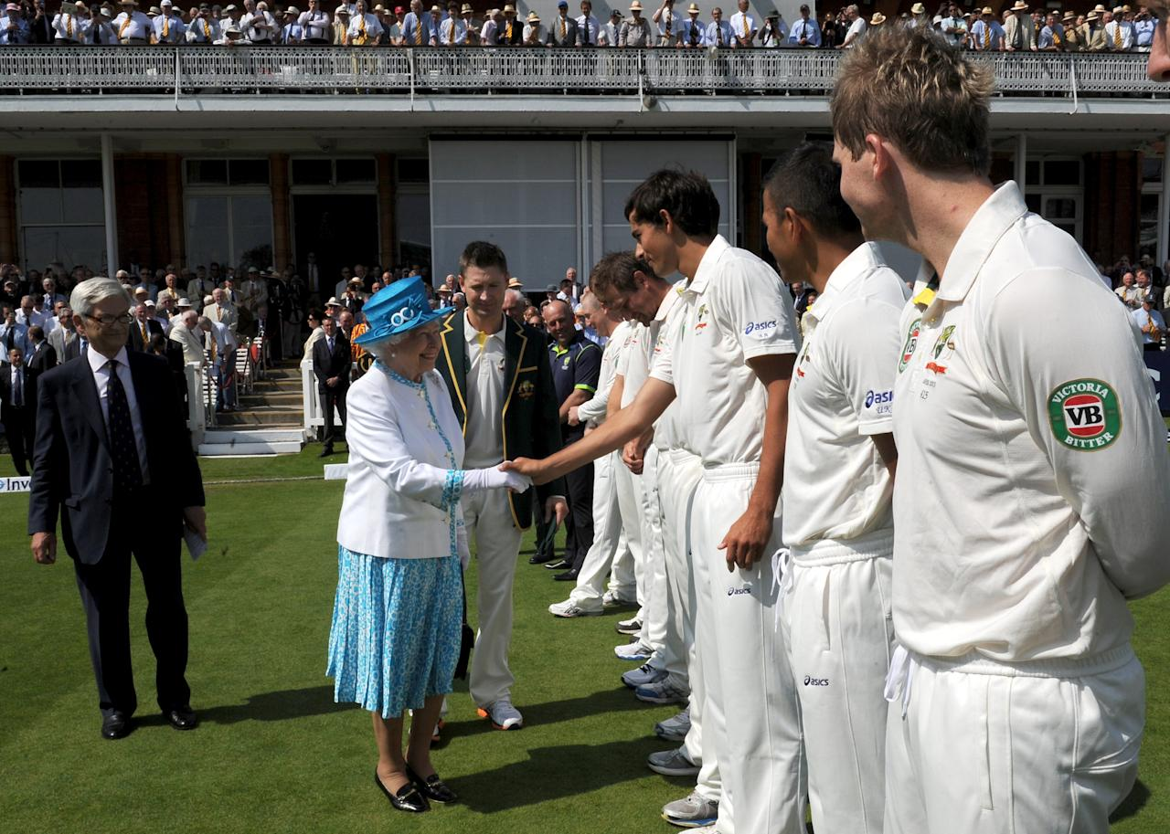 LONDON, UNITED KINGDOM - JULY 18: Queen Elizabeth II shakes hands with Australia's Ashton Agar ahead of the first day of the second test between England and Australia at Lord's Cricket Ground on July 18, 2013 in London, England. (Photo by Anthony Devlin - WPA Pool/Getty Images)