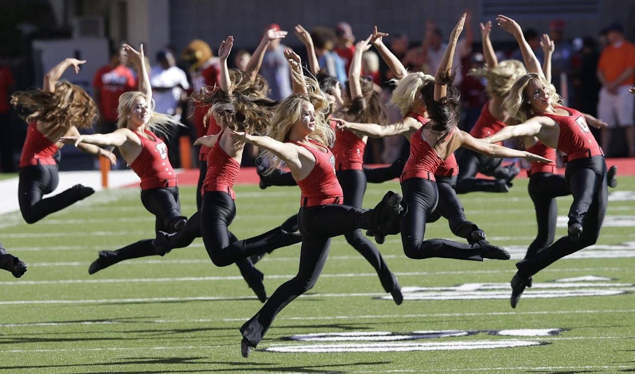 Members of the Utah dance team perform before the start of their NCAA college football game against Idaho State Thursday, Aug. 28, 2014, in Salt Lake City. (AP Photo/Rick Bowmer)