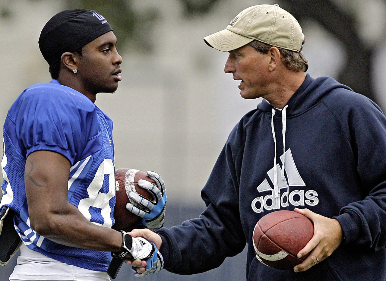 In this Tuesday Oct. 25,2011 photo UCLA head coach Rick Neuheisel greets Jerry Rice Jr., son of Hall of Famer Jerry Rice, a backup receiver at UCLA who has never played in a game, at football practice on the campus in Los Angeles. Rice Jr.'s new teammates at UCLA often do a double-take when they realize they're catching passes alongside the son of the greatest receiver in NFL history. The hard-working walk-on sophomore is eager to build his own name when he makes his expected debut for the suspension-depleted Bruins against California. (AP Photo/Reed Saxon)