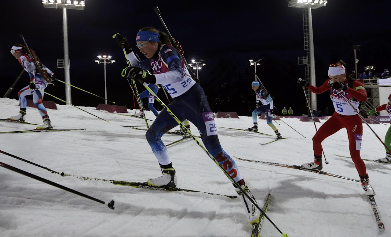 United States' Susan Dunklee, center, leads Switzerland's Selina Gasparin as she competes in the women's biathlon 12.5k mass-start, at the 2014 Winter Olympics, Monday, Feb. 17, 2014, in Krasnaya Polyana, Russia. (AP Photo/Felipe Dana)
