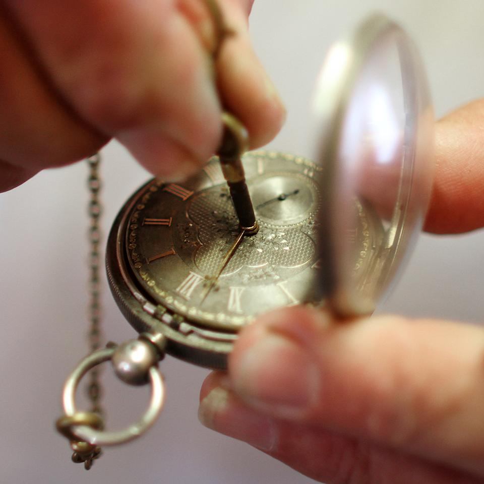 Mike Conroy - owner of Ye Old Watch shop in Portsmouth, Va. winds an antique Fusee pocket watch.