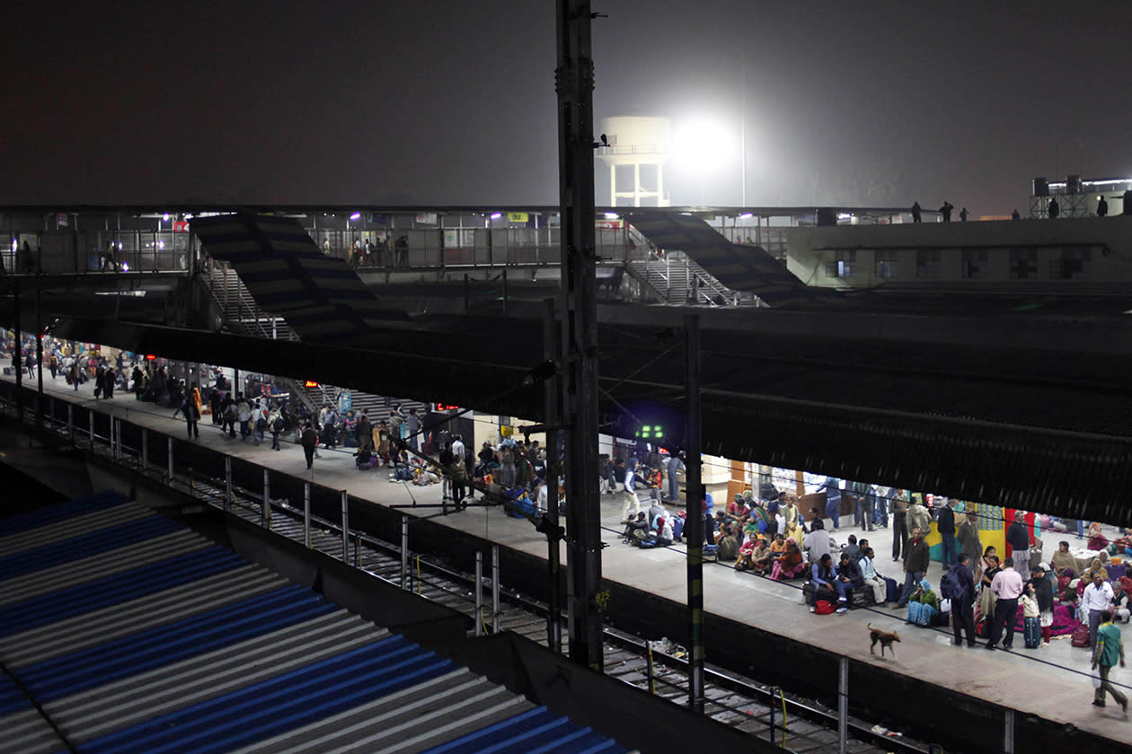 Indian passengers wait on a platform at a railway station in Allahabad, India.