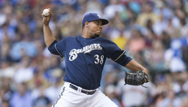 Peralta first to 14 wins, Brewers edge Giants 3-1