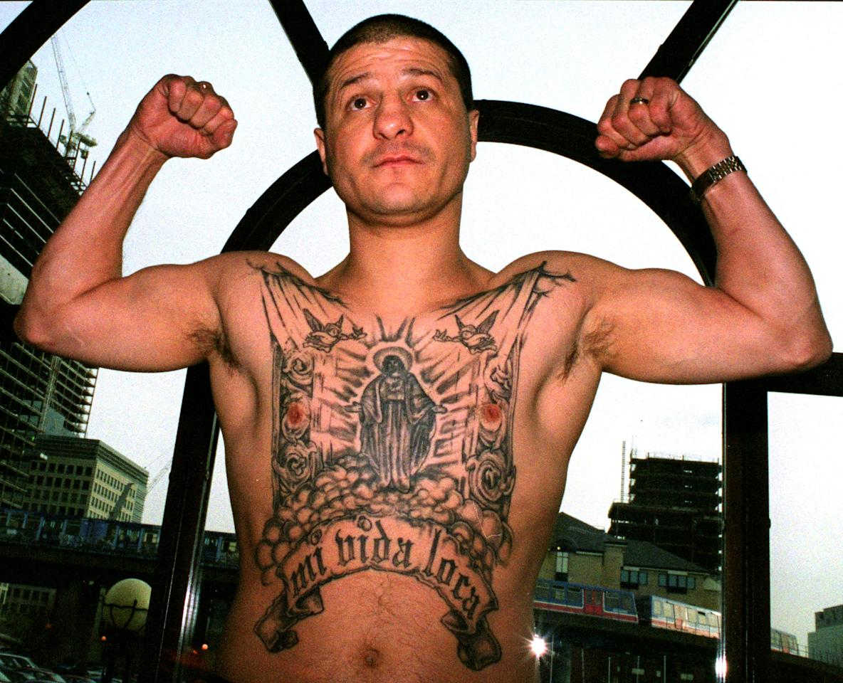 "LONDON, UNITED KINGDOM - JANUARY 15 2002:  Jonny Tapia of Albuquerque, USA shows off his tatoo's at a Press Conference before his fight against Eduardo Alvarez of Argentina held at the International Hotel in the Docklands, London.  Johnny Tapia has been found dead at his home in Albuquerque, New Mexico at the age of 45. Police reports have stated that the death ""did not appear to be suspicious"".  (Photo by Warren Little/Getty Images)"