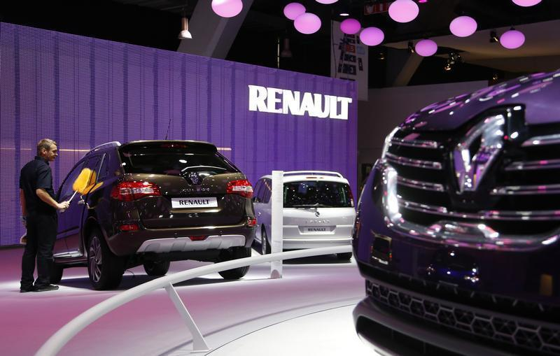A worker cleans a Renault car at the European Motor Show in Brussels