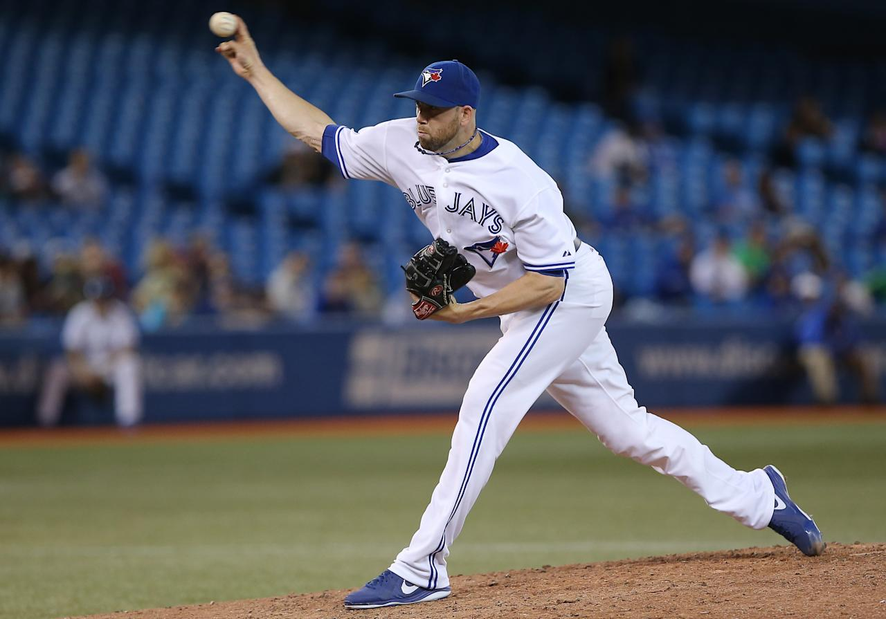 TORONTO, CANADA - JUNE 18: Steve Delabar #50 of the Toronto Blue Jays delivers a pitch during MLB game action against the Colorado Rockies on June 18, 2013 at Rogers Centre in Toronto, Ontario, Canada. (Photo by Tom Szczerbowski/Getty Images)