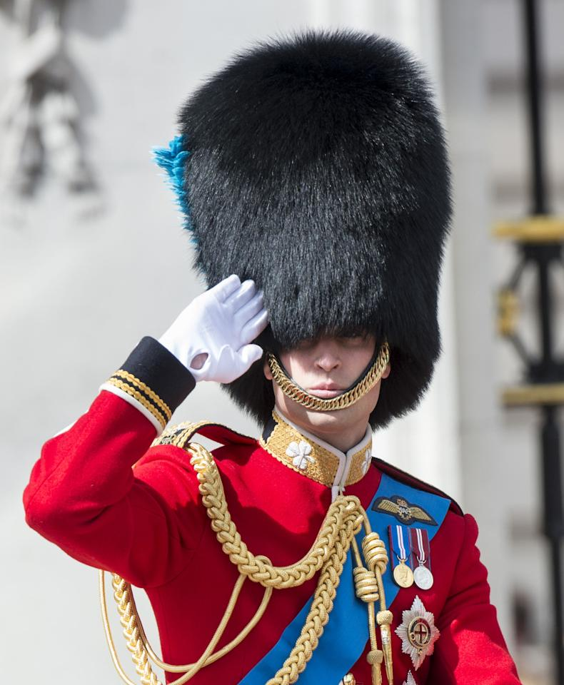 LONDON, ENGLAND - JUNE 15: Prince William, Duke of Cambridge during the annual Trooping The Colour ceremony at Horse Guards Parade on June 15, 2013 in London, England. Today's ceremony which marks the Queens official birthday will not be attended by Prince Philip the Duke of Edinburgh as he recuperates from abdominal surgery and will also be The Duchess of Cambridge's last public engagement before her baby is due to be born next month. (Photo by Mark Cuthbert/UK Press via Getty Images)