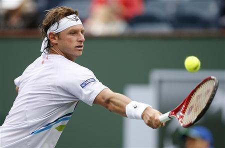 Nalbandian of Argentina returns a shot against Granollers of Spain during their match at the BNP Paribas Open ATP tennis tournament in Indian Wells, California