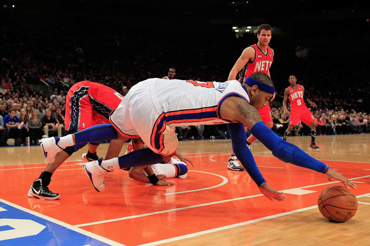 NEW YORK, NY - FEBRUARY 20:  Carmelo Anthony #7 of the New York Knicks dives for a ball against the New Jersey Nets at Madison Square Garden on February 20, 2012 in New York City. NOTE TO USER: User expressly acknowledges and agrees that, by downloading and/or using this Photograph, user is consenting to the terms and conditions of the Getty Images License Agreement.  (Photo by Chris Trotman/Getty Images)