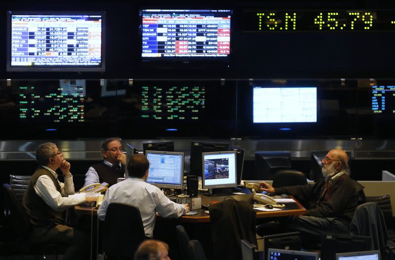 Argentine stockbrokers work on the floor of the Buenos Aires Stock Exchange