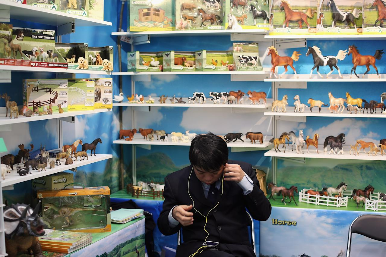 LONDON, ENGLAND - JANUARY 22:  A man sits on a trade stand during the 2013 London Toy Fair at Olympia Exhibition Centre on January 22, 2013 in London, England. The annual fair which is organised by the British Toy and Hobby Association, brings together toy manufacturers and retailers from around the world.  (Photo by Dan Kitwood/Getty Images)