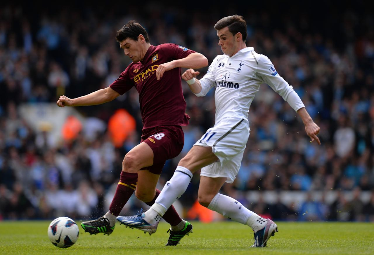 LONDON, ENGLAND - APRIL 21: Gareth Bale of Tottenham Hotspur tackles Gareth Barry of Manchester City during the Barclays Premier League match between Tottenham Hotspur and Manchester City at White Hart Lane on April 21, 2013 in London, England. (Photo by Shaun Botterill/Getty Images)