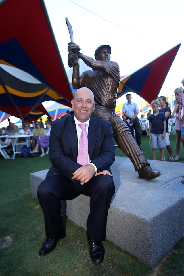 ADELAIDE, AUSTRALIA - JANUARY 25: Former test cricketer Darren Lehmann poses with a statue of himself after it was unveiled at the Adelaide Oval before day two of the Fourth Test Match between Australia and India at Adelaide Oval on January 25, 2012 in Adelaide, Australia.  (Photo by Morne de Klerk/Getty Images)
