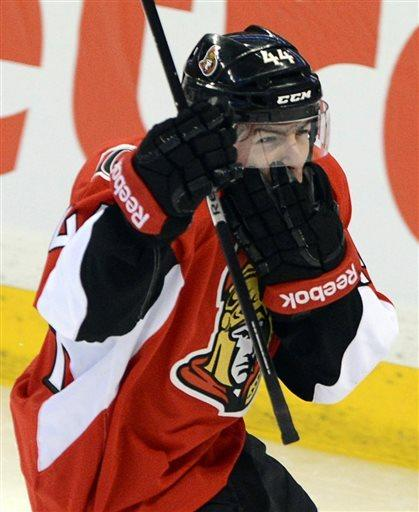 Ottawa Senators' Jean-Gabriel Pageau, right, celebrates a goal on Montreal Canadiens' Carey Price as he holds his face after getting a high stick from P.K. Suban during the second period of game three of first round NHL Stanley Cup playoff hockey at the Scotiabank Place in Ottawa on Sunday, May 5, 2013. (AP Photo/The Canadian Press, Sean Kilpatrick)