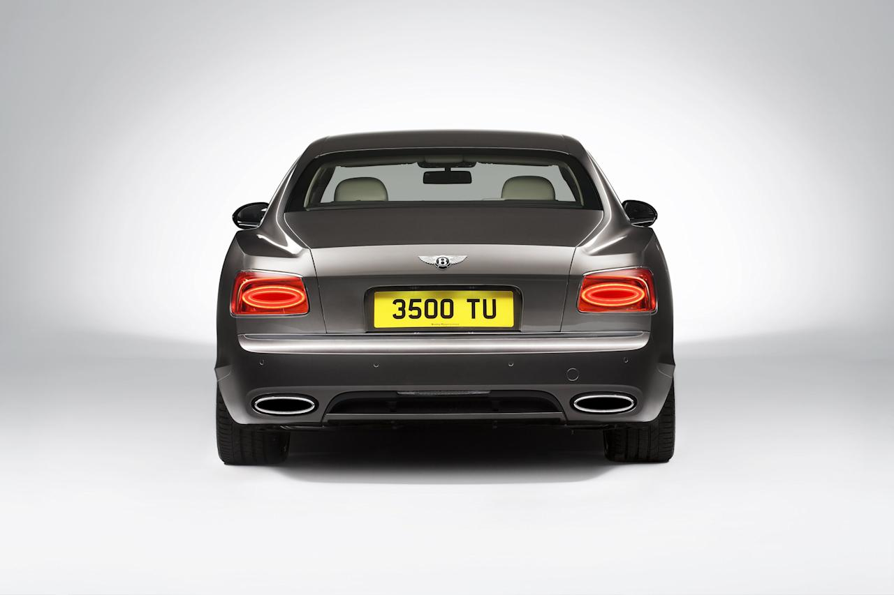 "At the rear, a longer and lower boot lid lends a more swept appearance to the side profile. Horizontal single ellipse LED tail lamps combine with a new interpretation of the Bentley ""Horse Shoe"" feature line, now running the full width of the car and encapsulating a graceful concave section."