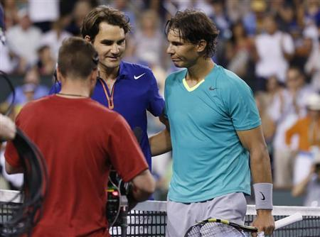 Federer of Switzerland greets Nadal of Spain at the net after Nadal defeated Federer in their men's singles quarterfinal match at the BNP Paribas Open ATP tennis tournament in Indian Wells