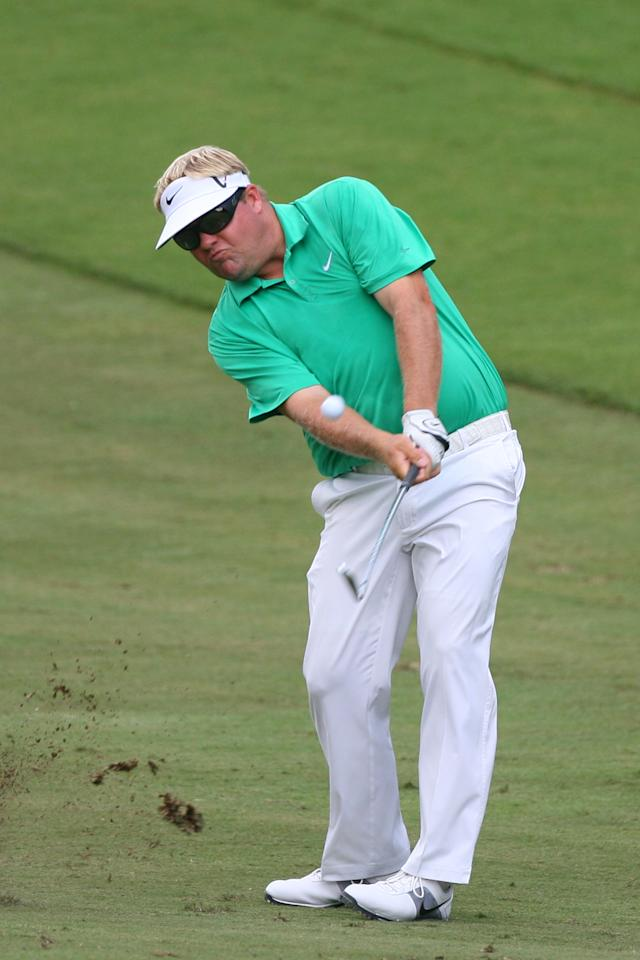 GREENSBORO, NC - AUGUST 18: Carl Pettersson hits his second shot on the 11th hole during the third round of the Wyndham Championship at Sedgefield Country Club on August 18, 2012 in Greensboro, North Carolina. (Photo by Hunter Martin/Getty Images)