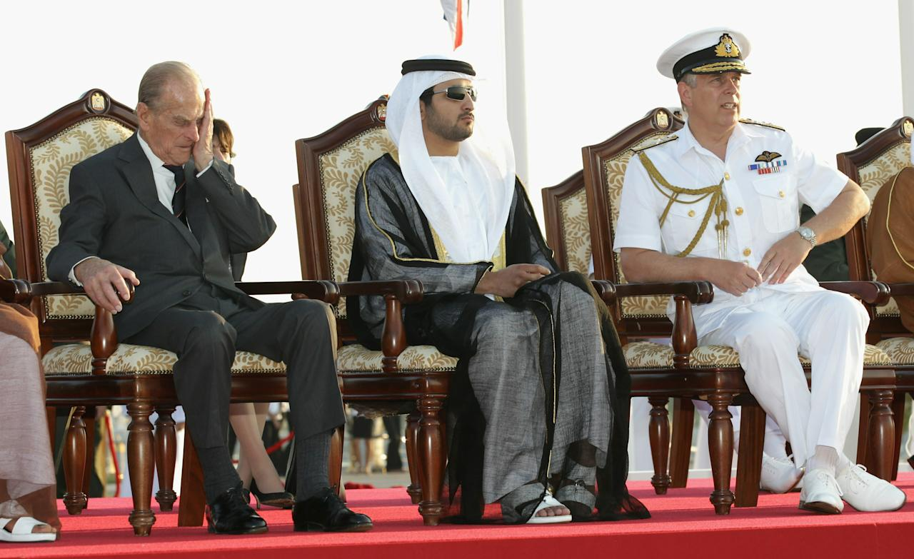 ABU DHABI, UNITED ARAB EMIRATES - NOVEMBER 25:  (L-R) Prince Philip, Duke of Edinburgh Sheikh Hamden Bin Mohamed Bin Rashed Al Maktoum and Prince Andrew, Duke of York attend a military air display event on November 25, 2010 in Abu Dhabi, United Arab Emirates. Queen Elizabeth II and Prince Philip, Duke of Edinburgh are on a State Visit to the Middle East. The Royal couple will spend two days in Abu Dhabi and three days in Oman.  (Photo by Chris Jackson/Getty Images)