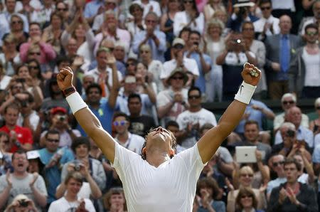 Rafael Nadal of Spain reacts after defeating Martin Klizan of Slovaki in their men's singles tennis match at the Wimbledon Tennis Championships, in London