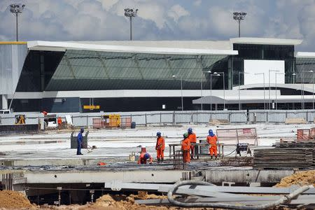 Labourers work at Manaus airport in Manaus
