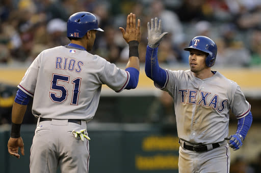 Rangers hit 4 HRs in 14-8 win over A's