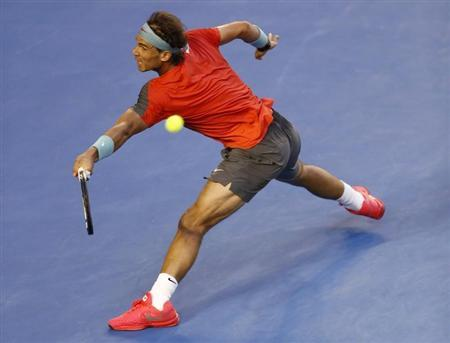 Rafael Nadal of Spain hits a return to Stanislas Wawrinka of Switzerland during their men's singles final match at the Australian Open 2014 tennis tournament in Melbourne