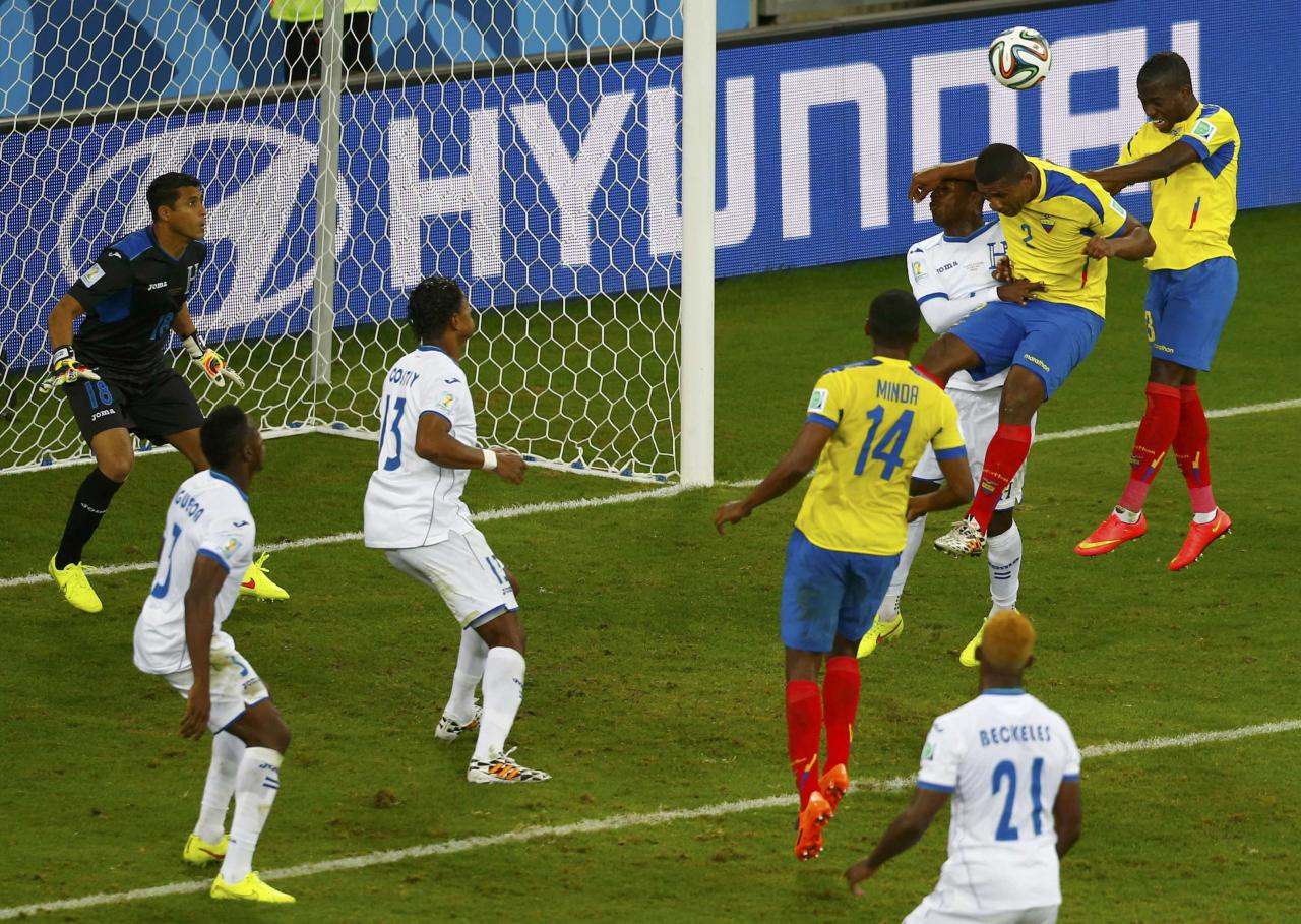 Ecuador's Enner Valencia (top R) heads the ball to score the team's second goal against Honduras during their 2014 World Cup Group E soccer match at the Baixada arena in Curitiba June 20, 2014. REUTERS/Amr Abdallah Dalsh (BRAZIL - Tags: SOCCER SPORT WORLD CUP TPX IMAGES OF THE DAY)