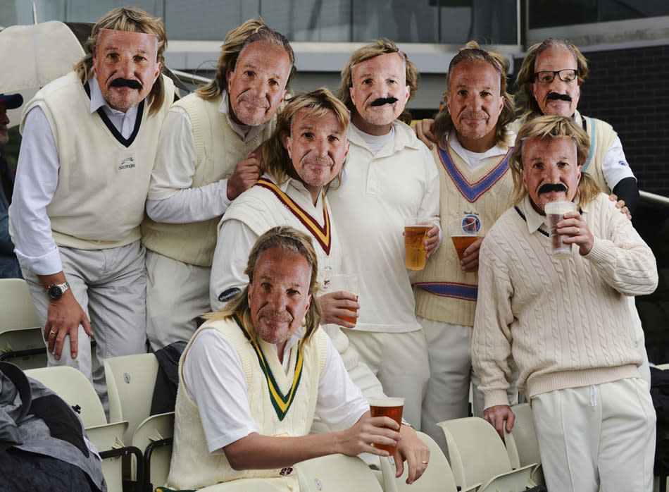A group of spectators wearing masks of former England cricket player Ian Botham, pose for a photograph during the third one-day international between England and Australia at Edgbaston cricket ground in Birmingham September 11, 2013. REUTERS/Philip Brown (BRITAIN - Tags: SPORT CRICKET TPX IMAGES OF THE DAY)