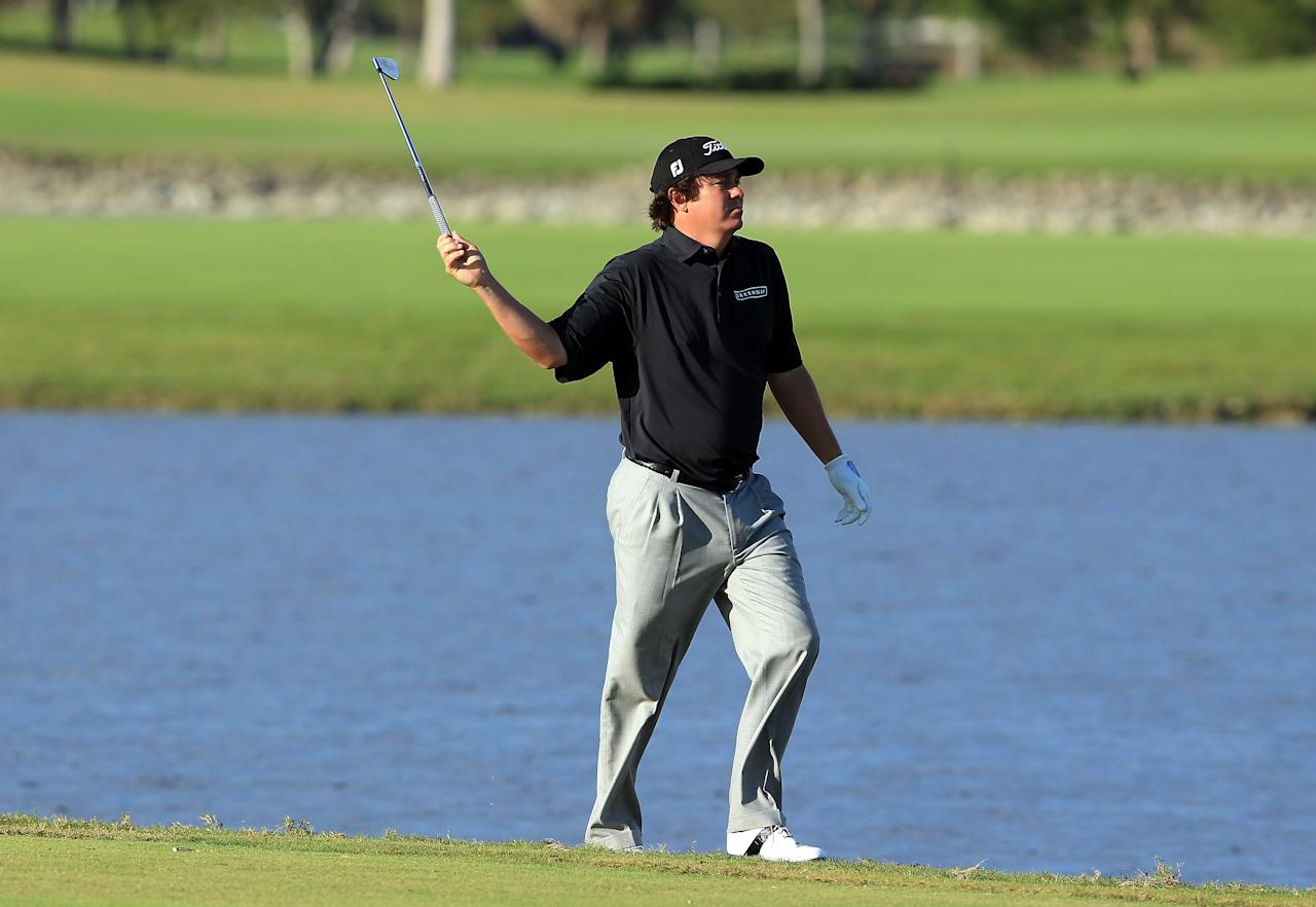MIAMI, FL - MARCH 10:  Jason Dufner of the USA plays his third shot at the par 4, 18th hole after his tee shot had finished in the water during the third round of the World Golf Championship Cadillac Championship on the TPC Blue Monster Course at Doral Golf Resort And Spa on March 10, 2012 in Miami, Florida.  (Photo by David Cannon/Getty Images)