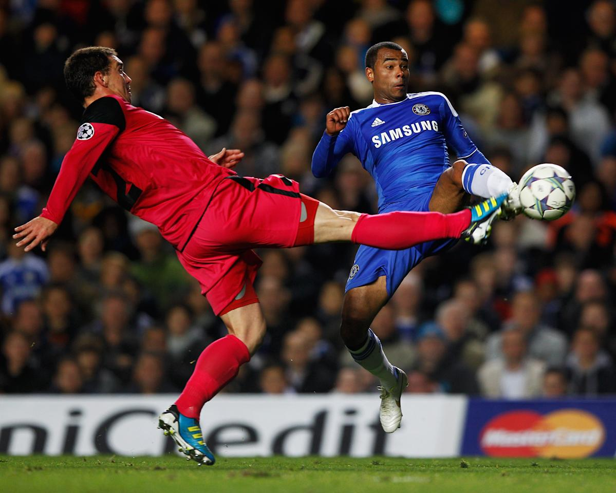 LONDON, ENGLAND - OCTOBER 19:  Ashley Cole of Chelsea challenges Abel Masuero of Genk during the UEFA Champions League group E match between Chelsea and Genk at Stamford Bridge on October 19, 2011 in London, England.  (Photo by Paul Gilham/Getty Images)