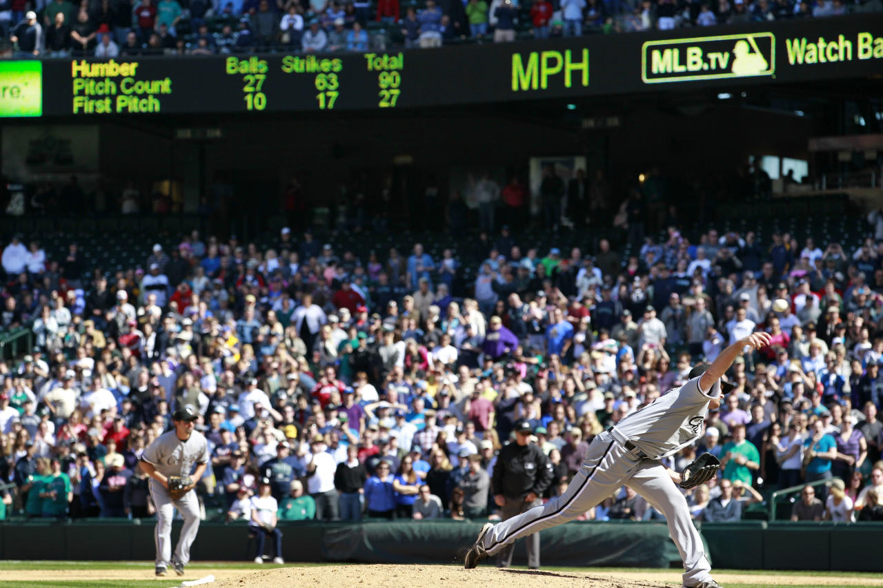 Chicago White Sox starter Phil Humber, right, throws one of his final pitches of his perfect baseball game against the Seattle Mariners, Saturday, April 21, 2012, in Seattle. The White Sox won 4-0. (AP Photo/Elaine Thompson)