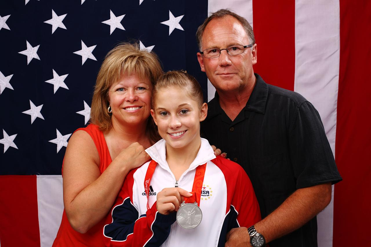 Shawn Johnson (C) of the United States poses with her parents Teri and Doug Johnson after placing second in the Women's all around Gymnastics event in the NBC Today Show Studio at the Beijing 2008 Olympic Games on August 15, 2008 in Beijing, China.