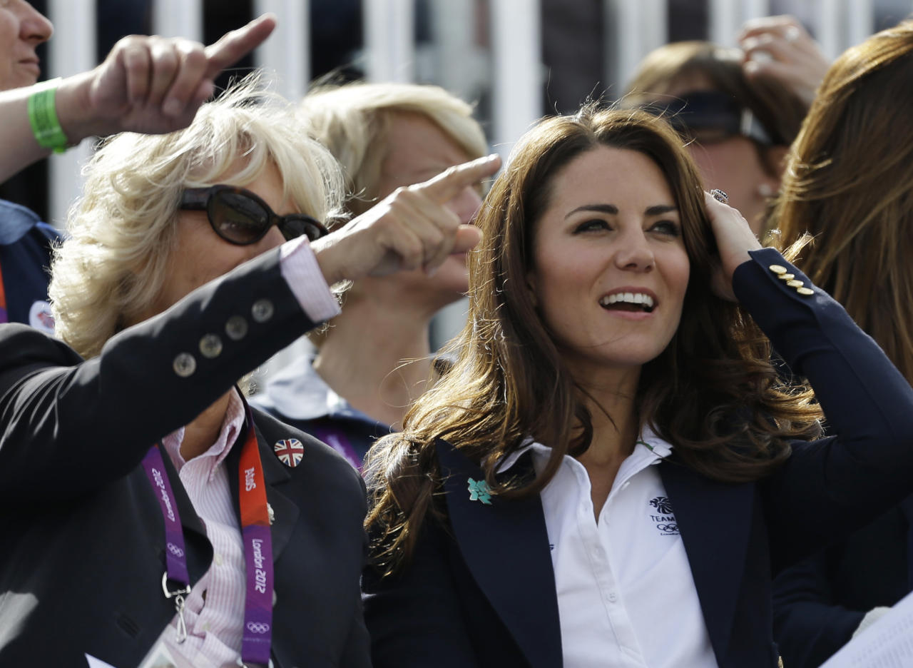 Camilla, Duchess of Cornwall, and Britain's Catherine, Duchess of Cambridge, watch the equestrian eventing cross country phase at the 2012 Summer Olympics, Monday, July 30, 2012, in London. (AP Photo/David Goldman)