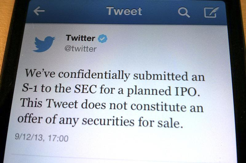 A tweet from Twitter Inc. announcing its initial public offering is shown in this photo illustration in Toronto
