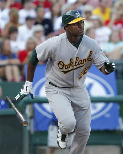 Oakland Athletics' Chris Carter runs toward first after hitting a home run off Texas Rangers pitcher Martin Perez in the second inning of a baseball game on Saturday, June 30, 2012, in Arlington, Texas. (AP Photo/Tim Sharp)