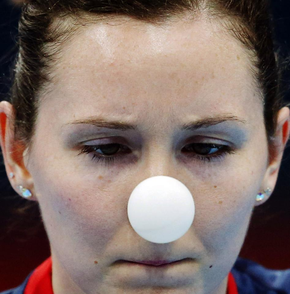 Joanna Parker of Great Britain competes against Kristin Silbereisen of Germany during their second round table tennis match at the 2012 Summer Olympics, Sunday, July 29, 2012, in London. (AP Photo/Sergei Grits)