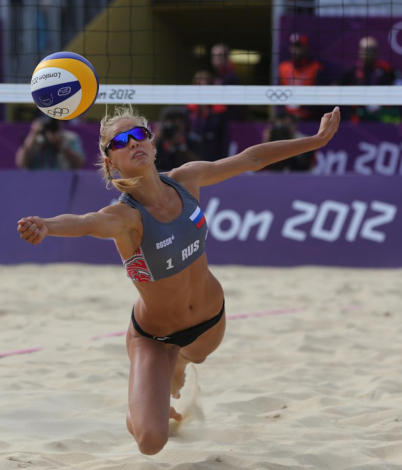 Anastasia Vasina from Russia dives for a ball during the Beach Volleyball match against China at the 2012 Summer Olympics, Saturday, July 28, 2012, in London. (AP Photo/Petr David Josek)