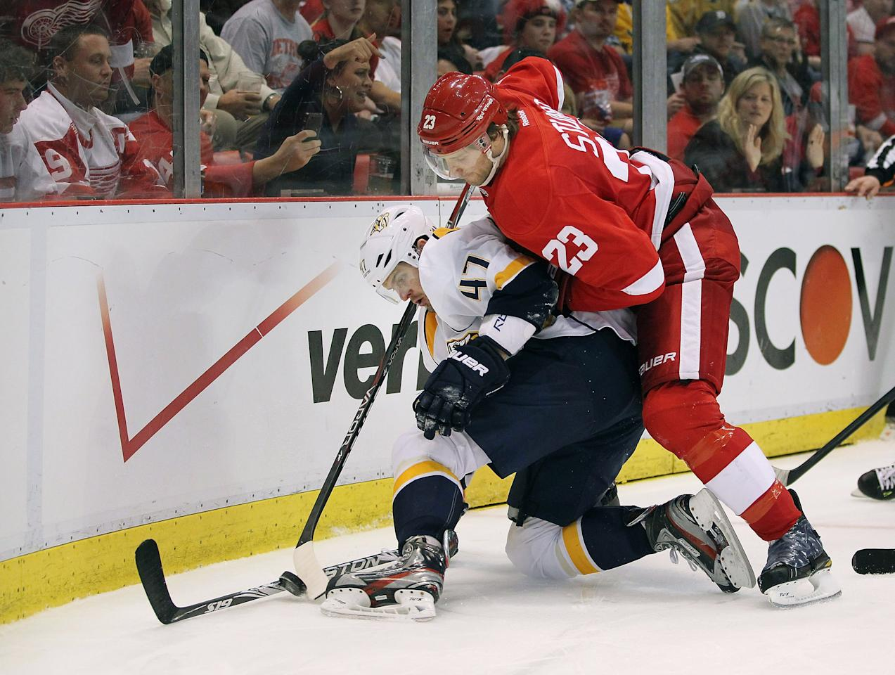 DETROIT, MI - APRIL 15: Alexander Radulov #47 of the Nashville Predators tries to control the puck in front of Brad Stuart #23 of the Detroit Red Wings during Game Three of the Western Conference Quarterfinals during the 2012 NHL Stanley Cup Playoffs at Joe Louis Arena on April 15, 2012 in Detroit, Michigan. (Photo by Gregory Shamus/Getty Images)